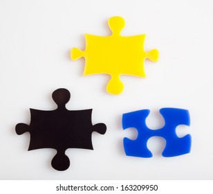 Three pieces of puzzle of color metaphor solution, business concept images