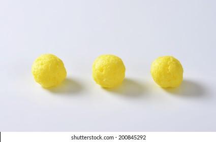 three pieces of round corn puffs