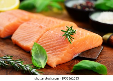 Three pieces of salmon with rosemary and basil