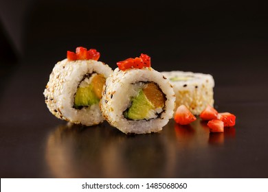 Three pieces of sushi roll on ambient background