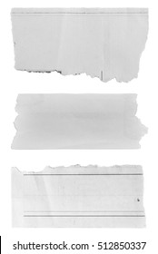 Three pieces of torn paper on plain background
