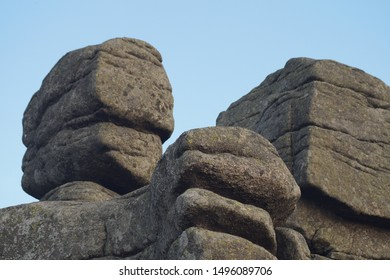 Three Piglets (Trzy Swinki) rock formations on the blue sky background in the Krkonose National Park, Giant Mountains, Sudety, Poland and Czech Republic border, Europe.