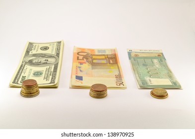 three piles of banknotes and banknotes on a white background