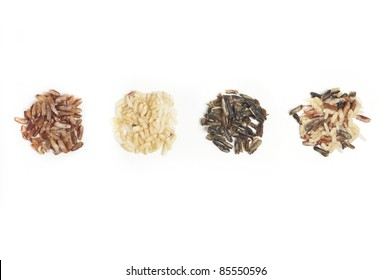 Three piles of different types of rice with mixed rice.