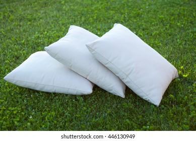 Three pillows on the grass