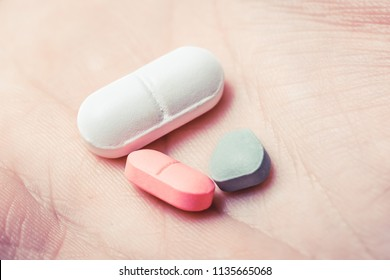Three Pills In The Middle Of A Hand