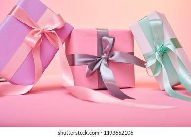 three pink gift boxes