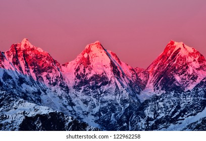 three pink snow clad peaks in Indian Himalayas