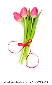 three pink tulips tied with a ribbon