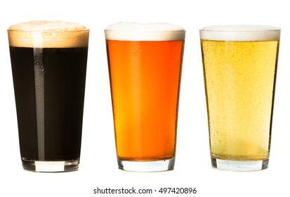 Three pints of craft beer stout ale pilsner lager isolated on white background