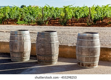 Three pipes for wine fermentation are standing on the background of vineyard,Pipes for wine fermentation