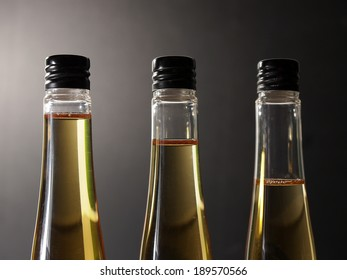 Three plastic bottles with golden syrup
