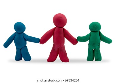 three plasticine persons over a white background