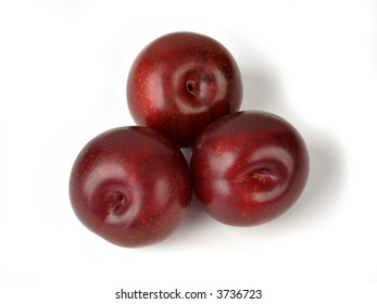 Three Plums isolated on a white background