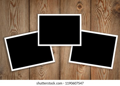 three polaroid on a wood background