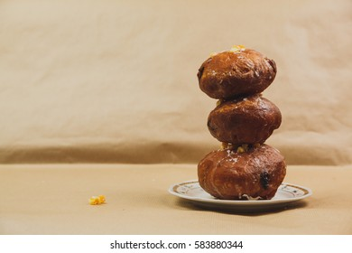 Three Polish doughnuts stacked on top of each other