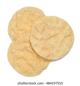 three poppadoms isolated on white background shot from above