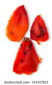 Three portions of succulent charred roasted red sweet pepper cooked over a summer barbecue or grilled in the oven, closeup overhead view on white