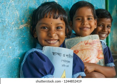 Three Portrait Girls smiling in school 1st January 2000, Medinipur, West bengal, India