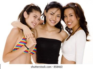 Three pretty asian women in summer wear on white background