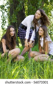 three pretty student girls with books outdoor