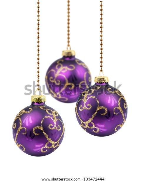 Three purple gold Christmas balls hanging on white background isolated