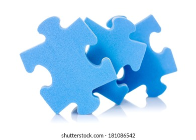 Three puzzle pieces with reflection on white background