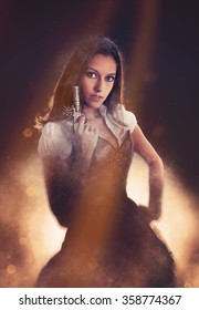 Three Quarter Length Portrait of Young Attractive Brunette Woman Wearing Old Fasioned Western Costume with Corset and Tutu Holding Antique Pistol and Looking at Camera through Sun Beam Overlay