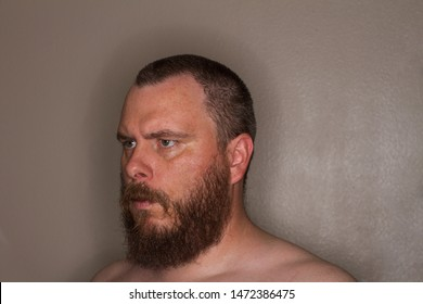 three quarter view of a bearded man looking at the distance