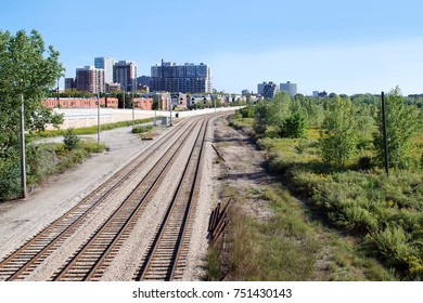 Three railroad tracks curve and vanish away into the distance