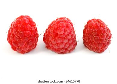 Three Raspberries isolated on white