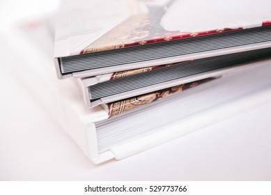 three ready photo albums