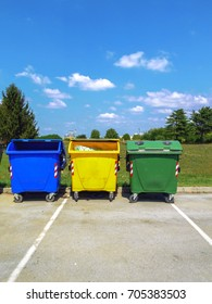 Three recycling containers in blue, yellow and green color. Waste separation