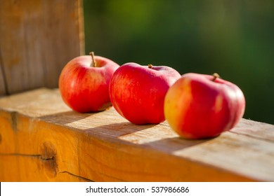 Three red apple on the porch