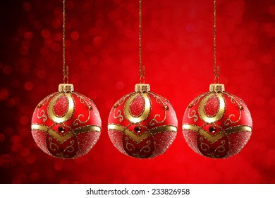 three red balls on red background space