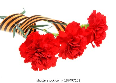 Three red carnations tied with Saint George ribbon isolated on white