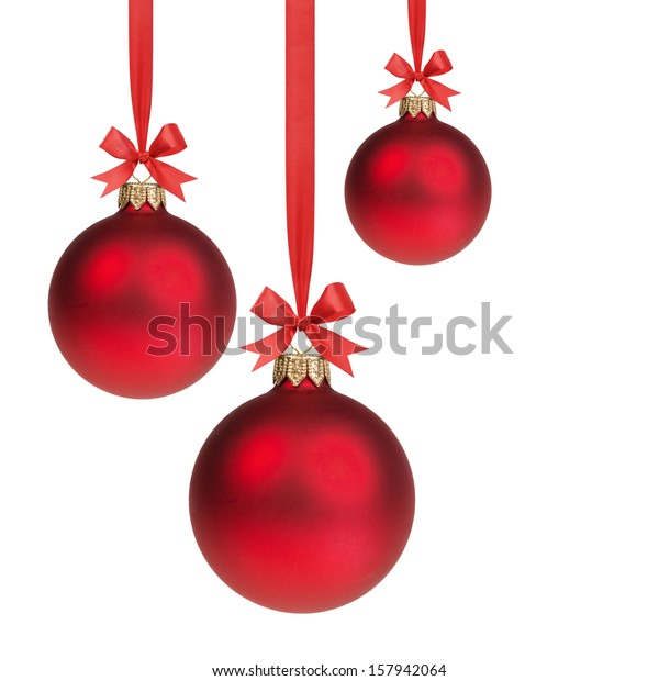 three red christmas balls hanging on ribbon with bows, isolated on white