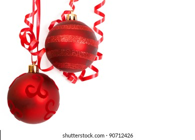 Three red Christmas baubles isolated on white background with copy space.