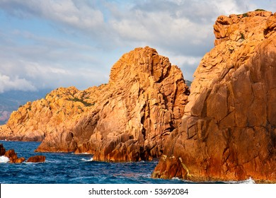 Three red cliffs in the sea