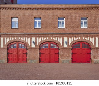 three red doors and four windows, fire squad station, in Saxony, Germany