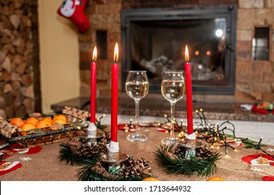 Three red fire candles and pair champagne glasses