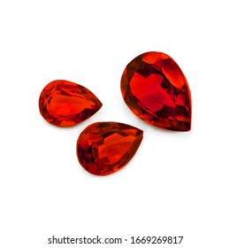 Three red gems on a white background. Pear facet red gemstones.