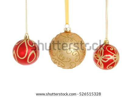 2d9d3747692b Three red and gold glitter Christmas baubles isolated against white