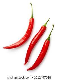 Three red hot chili peppers isolated on white background. Top view