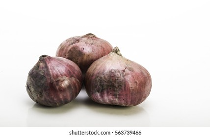 three red onion in closeup with white isolated background