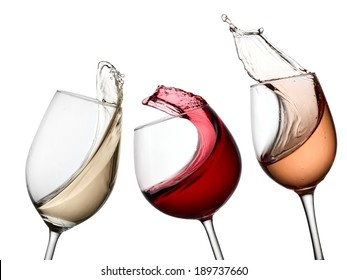 Three red, white and rose wine glasses up