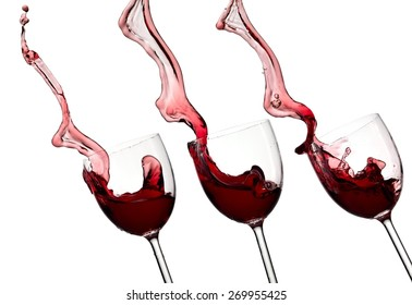 Three red wine glasses up