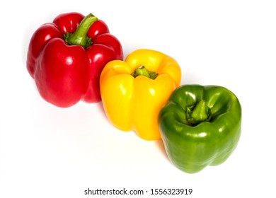 Three Red, Yellow, Green Peppers isolated on white background. Fresh vegetables