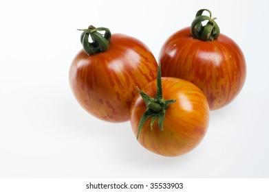 Three red zebra heirloom tomatoes.