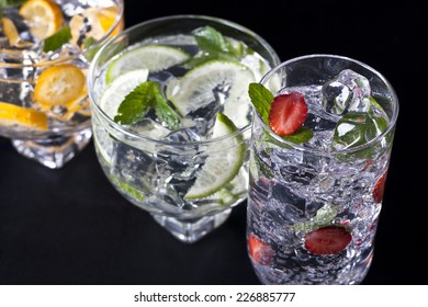 Three refreshing cocktails on a black background